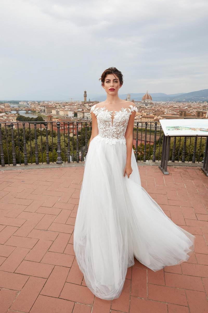 white wedding dress with open shoulders
