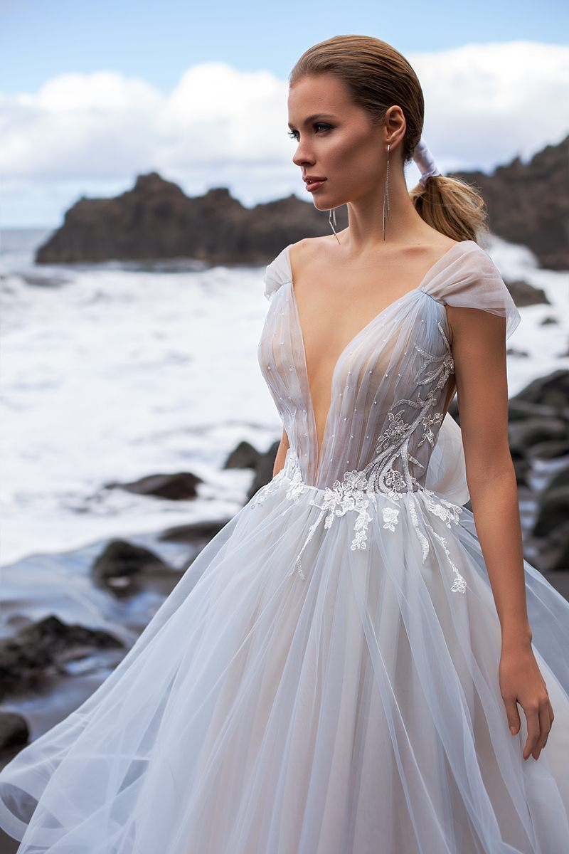wedding dress with a deep v deckline