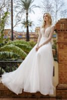 wedding gown with long sleeves and low back