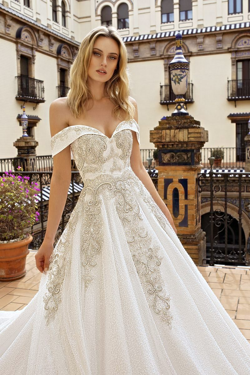 wedding dress with off the shoulders and long train