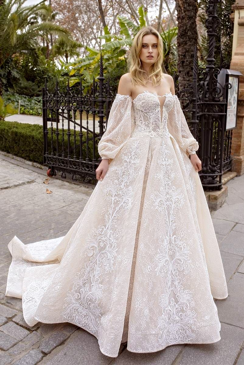 bridal gown with long sleeves and train
